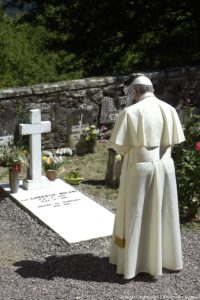 Pope Francis prays during a ceremony in Barbiana, near Florence, Italy, at the tomb of Don Lorenzo Milani, Tuesday, June 20, 2017. Pope Francis is making a pilgrimage to northern Italy to honor two 20th-century parish priests, Don Lorenzo Milani and Don Primo Mazzolari whose commitment to the poor and powerless brought them censure from the Vatican. ANSA/OSSERVATORE ROMANO PRESS OFFICE ++ NO SALES, EDITORIAL USE ONLY ++