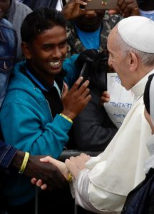 Pope Francis wears an identification bracelet as he shakes hands with with migrants at a regional migrant center, in Bologna, Italy, Sunday, Oct. 1, 2017. Pope Francis is in Cesena and Bologna for a one-day visit. (ANSA/AP Photo/Luca Bruno) [CopyrightNotice: AP]